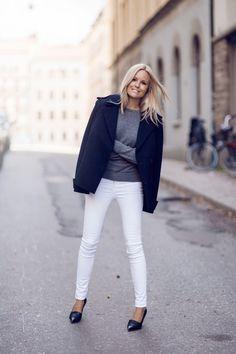 Gray sweater, white skinny jeans, navy short coat, black pointy heel loafer