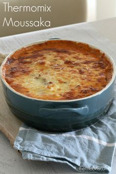 A deliciously easy Thermomix Moussaka that the whole family will love! Filled with layers of lamb mince, potatoes, eggplant and cheese sauce!
