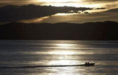 Titicaca Lake  People steer a boat at the Titicaca Lake in Tiquina, Bolivia, Tuesday March 13, 2012. The lake reached its highest level of water in years after an intense rainy season in the Andean region of Bolivia and Peru, authorities said. (AP Photo/Juan Karita)