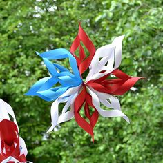 DIY Tutorial: Paper Starbursts - use Christmas papers for Christmas hanging garlands; an indoor decorating idea since tape is used.