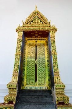 Thai temple doors decorated with stained glass and traditional designs