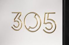 address signage in gold Art Deco typography
