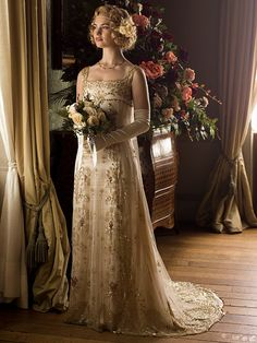 From Corsets to Flapper Chic: The Best Outfits in Downton Abbey History | ROSE'S WEDDING DRESS | It was only fitting that Rose had a less traditional wedding dress than her cousins – a sleeveless embellished gown, complete with a beaded headpiece. It's actually an original piece, dating back nearly 100 years.