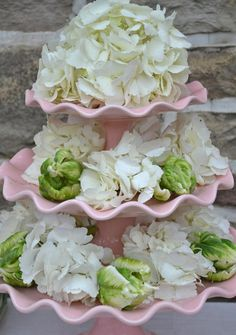 flowers on cake stands centerpiece- not these at all- but the general idea of flowers on cake stands as centerpieces