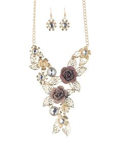 Take a look at this Crystal & Goldtone Rose Leaf Statement Necklace & Drop Earrings today!