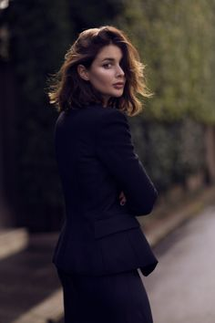 black slip dress and black balmain structured blazer with gold buttons