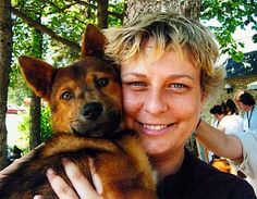 Tracey Hageny, founder of Animal Rescue and Veterinary Support Services, a 4th yr vet med student at the University of Wisconsin-Madison School of Vet Medicine, cuddles a mixed-breed dog rescued in MN,  during a meet & greet event. Meant to introduce rescued dogs fostered by ARVSS members to potential owners. Animals are spayed, fully vaccinated, neutered, checked for heartworms, placed on flea, tick & heartworm preventative, & microchipped. more than 70 dogs have found furever homes…
