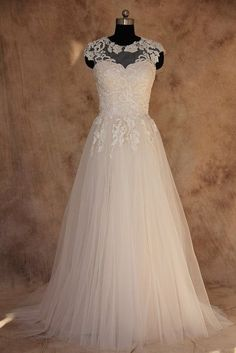 Illusion neck line bridal gowns like this are flattering for brides of all sizes. We make custom plus size wedding gowns as well as #replicas of couture dresses for less. Get pricing on any design from the internet to see how much you can save with our American dress design firm.