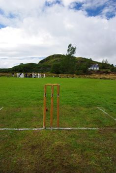 Scottish cricket comes home…   Today we played cricket against Mid Argyll Cricket club.  A really beautiful photo. Stump Vision is a common theme in Cricket Photography but this one is so simple and unpretentious. Lovely    What a ground! In the shadow of the ancient hill fort of Dunnad in Kilmartin Glen. There is something about played such a quintessentially English game (a discussion point- I know!) so close to the ancient seat of power of the Scots.