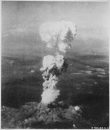 "August 6, 1945 Hiroshima Japan, a true ""weapon of mass destruction"". At the time this photo was made, smoke billowed 20,000 feet above Hiroshima while smoke from the burst of the first atomic bomb had spread over 10,000 feet on the target at the base of the rising column. (August 6, 1945)"