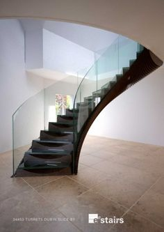 Staircase with steel carcass linked via vertical 'slices' of CNC'ed timber. Glass treads allow you to see the treads underneath / EeDesign Luxury Staircase, Timber Staircase, Staircase Railings, Winding Staircase, Stairways, Home Stairs Design, Interior Stairs, Round Stairs, Stairs In Living Room