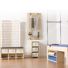Space-Saving Studio Furniture - Trapeze Table Storage | Pilates Equipment