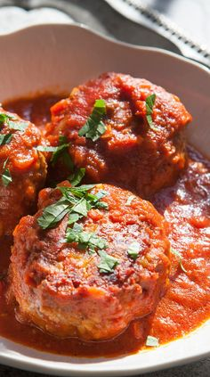 Classic Italian-American style Meatballs! huge, pillowy soft, loaded with herbs and cheese, mixed with ground beef and pork, served with a traditional tomato sauce.