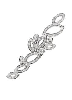Lily Cluster Barrette by Harry Winston. If money was no object and if I could be sure it wouldn't fall out and get lost ...  #Barrette #Harry_Winston