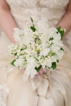 Such a romantic bouquet! Sweet pea and lily of the valley. Soft and petite.