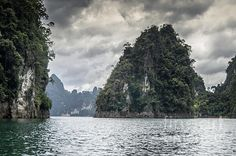 the rocks of Cheow Lan Lake Photograph by Michelle Meenawong