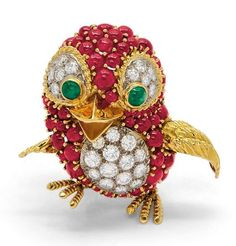 Of whimsical design, the scampering chick with textured wings and feet and polished beak, the body and head pavé-set with ruby cabochons and diamonds, to the cabochon emerald eyes, mounted in 18k gold