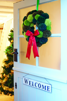 Festive wreath project from Pompom Christmas Twenty to Make book from Search Press