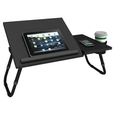 Check e-mails on your tablet or create a sketchpad masterpiece on this versatile lap desk, showcasing 4 adjustable positions and a cup holder. Laptop Tray, Laptop Table, Desk Tidy, Tidy Up, Ipad, Check Email, Lap Desk, Leg Work, Adjustable Legs