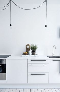 white kitchen with h