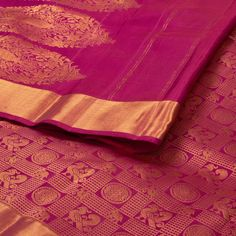 """The """"#Pink"""" #handwoven #Kanjivaram #Silk #Sari from Parisera is woven with peacocks and chakram motifs all over the body that is set off by a gold zari border on either side. An attractive floral motifs in gold zari adorn the magenta pallu. The border is repeated on the magenta blouse that completes the sari."""