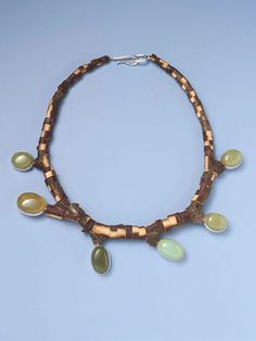 Terhi Tolvanen- Untitled 2004. Necklace Ø 19 cm. Wood, silver, jade. Private collection.