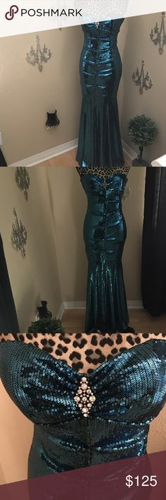 Beautiful blue-green sequence mermaid dress XScape by Joanna Chen mermaid prom or homecoming dress. Beautiful blue to green strapless gown with stunning shimmer from the all-over sequence. It has a beautiful faux diamond-crystal broach at the bust. Bust has pleating and boning. Bodice is ruched in the front and back. Slight tail at the back. Worn once. Size 6. Xscape Dresses Prom