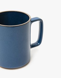 From Hasami Porcelain, a porcelain mug in Blue. Matching handle. Glazed Interior and exterior. Unglazed lip and base. Stamped logo. • Semi-porcelain • Microwave safe • Dishwasher safe • Not to be used on an open flame • Not safe for oven use • M