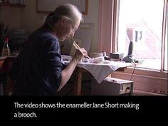 Jane Short, enamellist, making a silver brooch using 2 techniques, champléve & basse taille. Similar to each other except basse-taille always uses translucent enamel which covers the raised & recessed areas of the piece, where as champlevé covers just the recesses & may use opaque enamels.