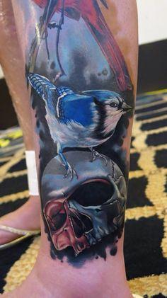 Phatt German artist- realistic color birds and skull tattoo