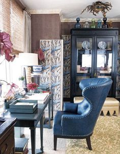 I don't know why this space is so charming to me.. Maybe it's the color or the quirky little accessories. Or the thought of doing work in a big fat wing chair as opposed to a crappy little desk chair.
