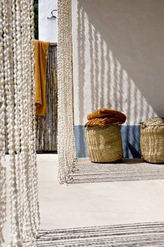 Seashell beaded curtain for a beach house from locally collected shells