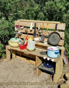 Diy mud kitchen for children. Mud pie kitchen made from old pallet