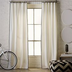 White curtain with black trim. Would be cute with deep false valance trimmed in black as well (p. 67 LA Windows)