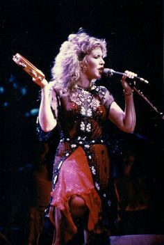 Stevie onstage ~ ☆♥❤♥☆ ~ so beautiful in red and black and showing a bit of knee while performing a song from her 'The Wild Heart' album, 1983 ~ https://en.wikipedia.org/wiki/The_Wild_Heart_(album)