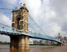 The John A. Roebling Suspension Bridge spans the Ohio River between Cincinnati, Ohio and Covington, Kentucky. When the first pedestrians crossed on December 1, 1866, it was the longest suspension bridge in the world at a 1,057 feet main span.