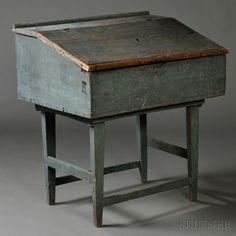 Blue-painted Desk Box on possibly Chester, New Hampshire, early 19th century, the lift-top opens to a deep well and sits on a taper-leg stretcher base.