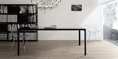 LEGIO - Furniture: Flat table with black aluminium structure and a glossy, black table top in lacquered glass from Rimadesio