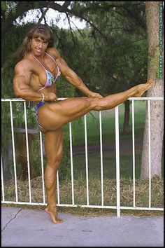 IFBB Pro female bodybuilder Denise Hoshor posing her impressive muscles and great legs on WPWMAX!