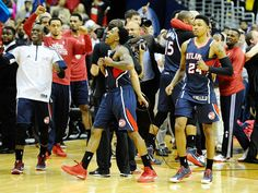Atlanta Hawks players celebrate after the game against the Washington Wizards in game six of the second round of the NBA Playoffs at Verizon Center.  Brad Mills, USA TODAY Sports