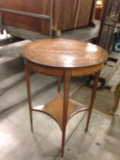French antique round inlayed wood end table.
