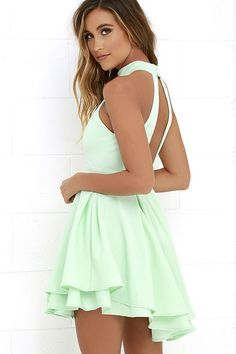 When the spotlight falls on you, youll be grateful to be donning a number as cute as the Dress Rehearsal Mint Green Skater Dress! Medium-weight woven fabric falls from a halter neckline into a princess seamed bodice with wide arm openings. Neckline fastens at back above a cutout before meeting a banded waist and full, skater skirt.
