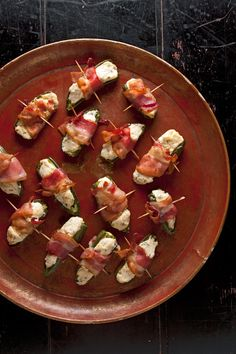 Bacon-Wrapped Jalapeño Poppers-- This addictive finger food is a perfect marriage of textures and flavors: creamy, chive-flecked cheese cuts the bite of roasted jalapeños, while crispy bacon adds crunch.