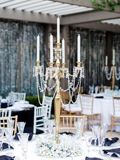 It's time to take your wedding centerpieces up a notch with decadent sparkles, beaded embellishments and towering vases. Take a look at these 13 glamorous centerpieces with serious bling.