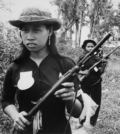 Vietnam War. Girl volunteers with fine manicures and jewelry, are part of the People's Self-Defense Force of Kien Dien, a hamlet of Ben Cat district 50 kilometers north of Saigon. They are patrolling the hamlet's perimeter to discourage Viet Cong infiltration. Ca. 1960.