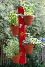 Kuvahaun tulos haulle wood flower pot hanger garden