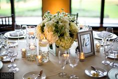 Blossoms, cream and white floral centerpieces with candles