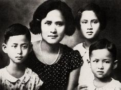 The queen mother with her 3 children, of whom the then Prince Bhumibhol Adulyadej was the youngest child.