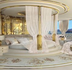 Luxury bedroom with intricate golden flower designs on walls and floors with gorgeous drapes and golden column