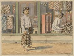 A Javanese boy passes a batik shop by J van der Heyden (circa 1920)